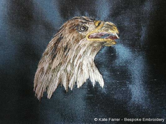 Silkshaded or needle painted eagle on silk background in a long and short stitch