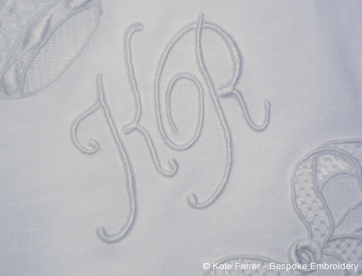 Detail of hand embroidered fine monogram in trailing and padded satin or raised satin