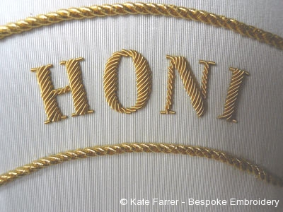 Cutwork smooth purl letters over string padding