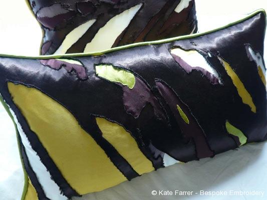 Appliqué cushions using procion dye and reverse appliqué